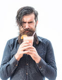 Bearded man with nonalcoholic cocktail. Handsome bearded man with stylish hair mustache and long beard on serious face holding glass of nonalcoholic cocktail Stock Image