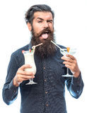 Bearded man with nonalcoholic cocktails. Handsome bearded man with stylish hair mustache and long beard on dissatisfied face holding glass of nonalcoholic Stock Photography