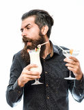 Bearded man with nonalcoholic cocktails. Handsome bearded man with stylish hair mustache and long beard on dissatisfied face holding glass of nonalcoholic Stock Image
