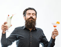 Bearded man with nonalcoholic cocktails. Handsome bearded man with stylish hair mustache and long beard on satisfied face holding glass of nonalcoholic cocktails Stock Photos
