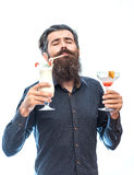 Bearded man with nonalcoholic cocktails. Handsome bearded man with stylish hair mustache and long beard on satisfied face holding glass of nonalcoholic cocktails Royalty Free Stock Photos