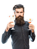 Bearded man with nonalcoholic cocktails. Handsome bearded man with stylish hair mustache and long beard on serious face holding glass of nonalcoholic cocktails Stock Photo