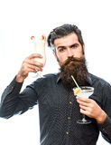 Bearded man with nonalcoholic cocktails. Handsome bearded man with stylish hair mustache and long beard on serious face holding glass of nonalcoholic cocktails Stock Image