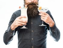Bearded man with nonalcoholic cocktails. Bearded man with stylish hair mustache and long beard drinking and holding glass of nonalcoholic cocktails isolated on Royalty Free Stock Image