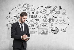 Bearded man with notebook and idea sketch Stock Photography