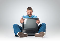 Bearded man with a old TV Royalty Free Stock Images
