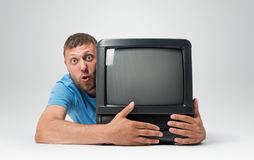Bearded man with a old TV Stock Photos