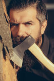 Bearded man outdoor with axe Royalty Free Stock Photo