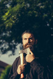 Bearded man outdoor with axe Royalty Free Stock Image