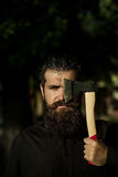 Bearded man outdoor with axe Stock Photography