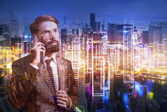 Bearded man on phone and the city Royalty Free Stock Photography