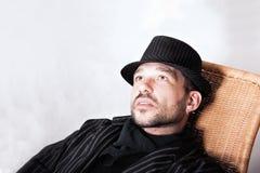 Bearded Man With Pierced Ear In Black Hat Stock Photo
