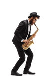 Bearded man playing a saxophone Royalty Free Stock Images