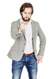 Bearded man pointing his finger against somebody. human emotion, Royalty Free Stock Photos