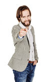 Bearded man pointing his finger against somebody. human emotion, Royalty Free Stock Photo