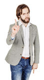 Bearded man pointing his finger against somebody. human emotion, Royalty Free Stock Images