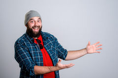Bearded man is pointing to the side Royalty Free Stock Photography
