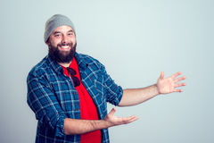 Bearded man is pointing to the side Stock Photos