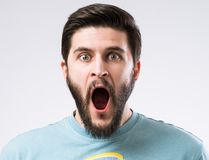 Bearded man portrait. Portrait of bearded man with opened mouth and amazed emotion on face Royalty Free Stock Photos