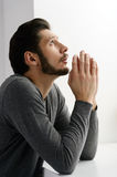 Bearded man praying. Portrait of bearded man praying to god and Stock Images