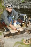Bearded man prepares coffee in the mountains of the Carpathians, Ukraine Stock Image
