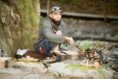 Bearded man prepares coffee in the mountains of the Carpathians, Ukraine Royalty Free Stock Photos