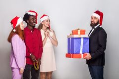 Bearded man present gift him friend and looking at camera with p. Bearded men present gift him friend and looking at camera with proudly face. Christmas and stock photos