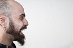 Bearded man in profile that laughs Royalty Free Stock Image