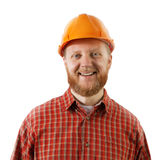 Bearded man in a protective construction helmet Stock Images
