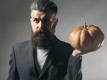 Bearded man with pumpkin Stock Photography
