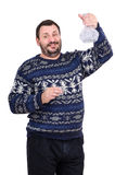 Bearded man raises carafe of vodka. Smiling middle-aged bearded man raises crystal carafe of vodka Stock Photo