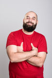 Bearded man in red shirt and crossed arms Stock Images