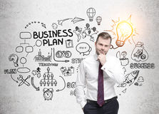 Bearded man with red tie and business plan sketch Stock Photos