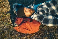 Bearded man relax outdoor in sunset. hiking and camping. adventure traveling. Mature hipster with beard. brutal. Caucasian hipster with moustache. Bearded man royalty free stock photography