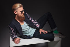 Bearded man relaxes in studio Stock Photography