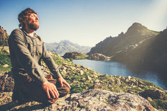 Bearded Man relaxing alone with nature Travel Lifestyle concept. Lake and mountains landscape on background outdoor royalty free stock photos