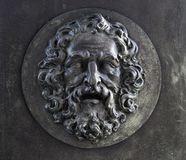 Bearded Man Relief. A stylized iron relief of a bearded man Royalty Free Stock Photos