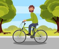 abccb3d21fd2 Bearded man riding bike in the park, healthy and active lifestyle, eco  friendly alternative