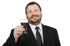 Bearded man rises glass a dark beer. Smiling bearded man rises glass a dark beer on a white background Stock Images