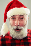 Bearded man in santa cap Stock Images