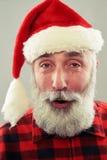 Bearded man in santa cap Stock Images