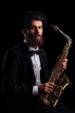 Bearded man with a saxophone Royalty Free Stock Image