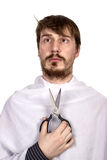 Bearded man with scissors Stock Images