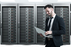 Bearded man in a server room Royalty Free Stock Photos