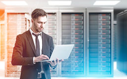 Bearded man in a server room, sunlight Royalty Free Stock Photography
