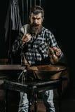 Bearded man shaves with razor Royalty Free Stock Photo