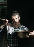 Bearded man shaves with razor Stock Photos