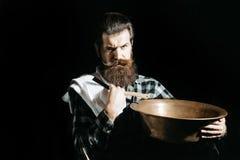 Bearded man shaves with razor Royalty Free Stock Photos