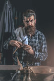Bearded man shaves with razor Royalty Free Stock Images