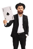 Bearded man showing an ace of spades card. Isolated on white background Royalty Free Stock Photography